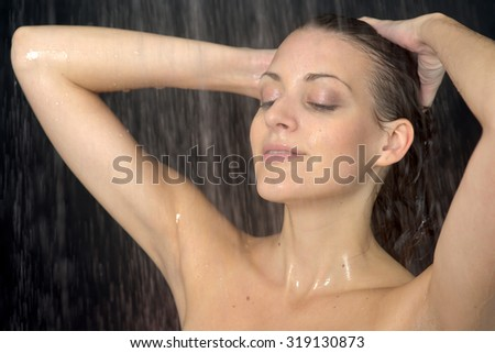 Beautiful woman standing at the shower