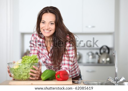 Beautiful woman standing in kitchen