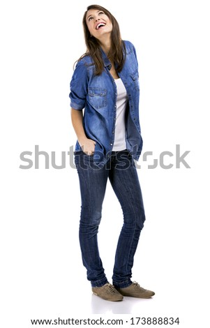 Beautiful woman standing over a white background with hands on the pockets and smiling - stock photo