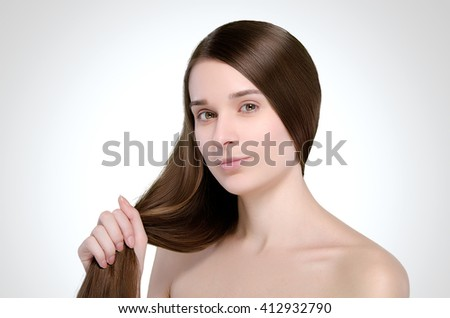 Beautiful woman. Straight long hair. Natural. Portrait. Concept.