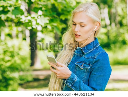 Beautiful woman summer portrait with mobile phone