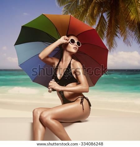 Beautiful woman sunbathing at the seaside - stock photo