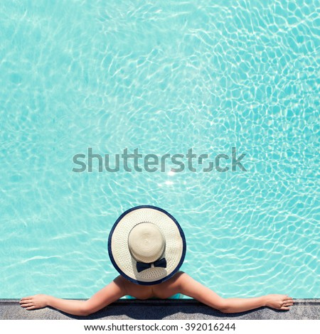 Beautiful woman sunbathing by the pool top view. Summer background for poster. Mock up for design. - stock photo