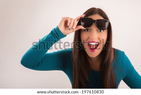 Beautiful woman surprised with sunglasses