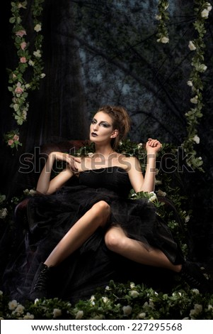 Beautiful woman surrounded by flowers and quirky environment - stock photo