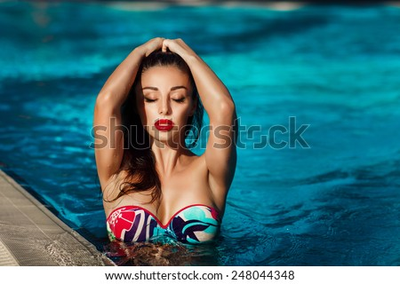 Beautiful woman swimming pool summer vacation summertime, sexy girl bikini fashion, tanned female model, girl having fun on beach, luxury lifestyle, series - stock photo