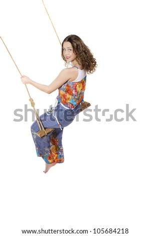 Beautiful woman swinging on the swing isolated on white - stock photo