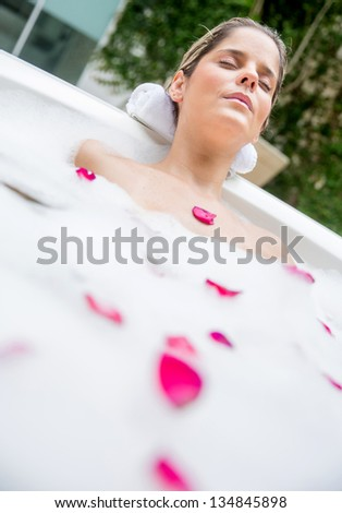 Beautiful woman taking a foam bath after a long day - stock photo