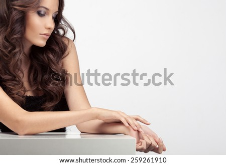Beautiful woman taking care of her hands. Space for text. - stock photo