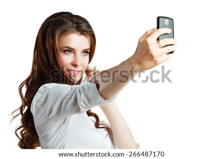 Beautiful woman taking self picture with smartphone camera - stock photo