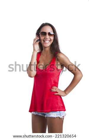 Beautiful woman talking at cell phone, isolated over white background