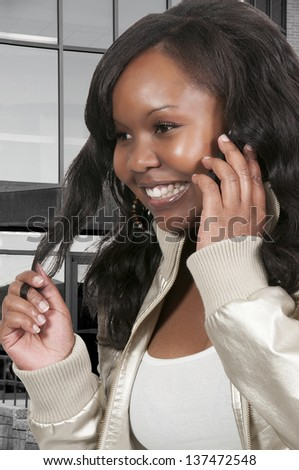 Beautiful woman talking on a cell phone - stock photo