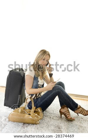 beautiful woman talking on her mobile before her trip