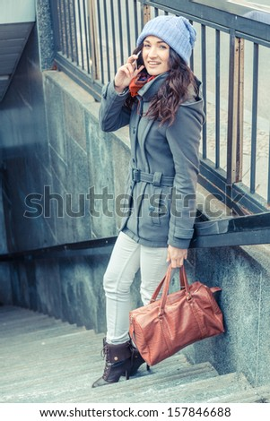 Beautiful Woman Talking on Mobile Phone, Urban Context - stock photo