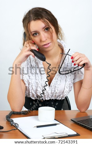 Beautiful woman talking phone in the office
