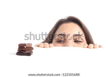 Beautiful woman tempted by chocolate on a white isolated background