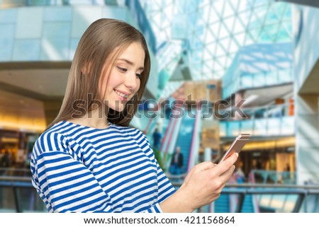 Beautiful  woman texting on her cell phone