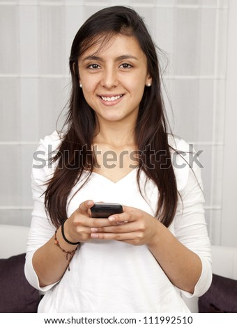 Beautiful woman texting using a mobile phone - stock photo