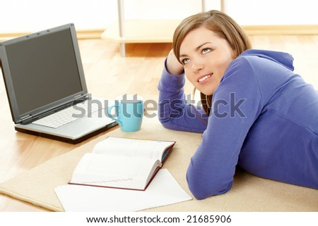 Beautiful woman thinking in home with laptop and papers