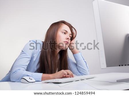 Beautiful woman tired at work - stock photo