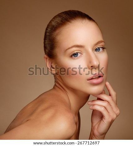 Beautiful Woman Touching her Face. Perfect Fresh Skin. Pure Beauty Model. Youth and Skin Care Concept