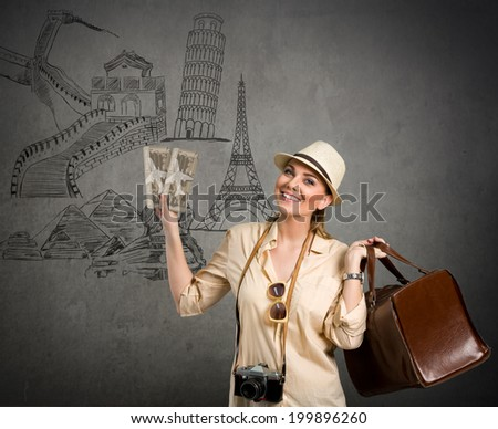 Beautiful woman tourist with landmarks from different cities on the background, concept - travel around the world - stock photo