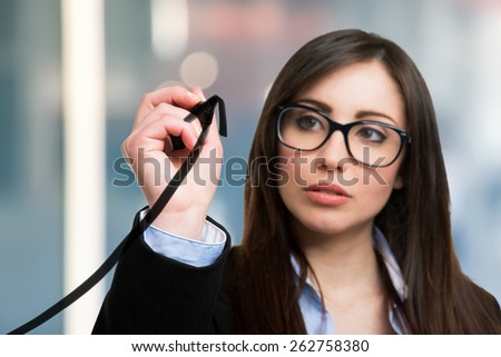 Beautiful woman tracing a rising arrow, representing business growth - stock photo