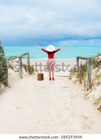 beautiful woman traveler in retro style dress  on the beach - stock photo