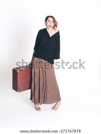 Beautiful woman traveler with a large suitcase isolated - stock photo