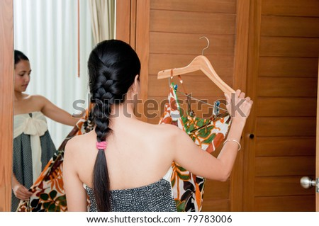 Beautiful Woman try cloth in dressing room