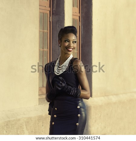 Beautiful woman turning head smiling - stock photo