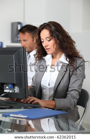 Beautiful woman typing on computer desk