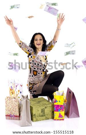 Beautiful woman under a money rain - stock photo