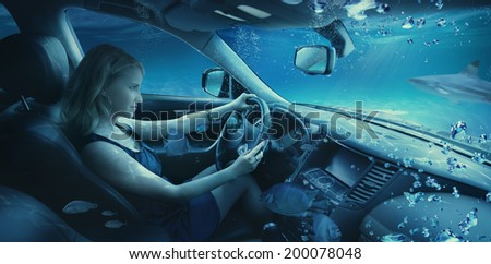 Beautiful woman underwater in the car - stock photo