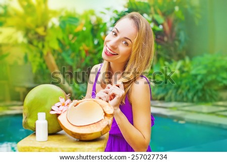 beautiful woman using coconut for her beauty care - stock photo