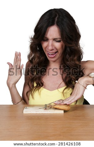 Beautiful woman using the mouse trap diet plan - stock photo