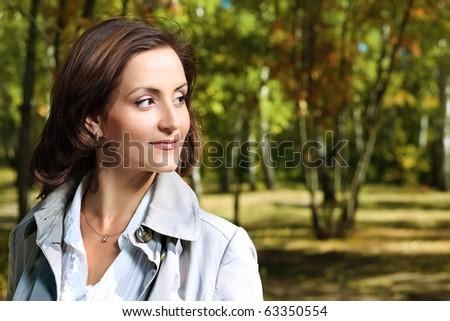 Beautiful woman walking at the autumn park. - stock photo