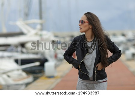 Beautiful woman walking in marina, Italy