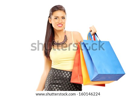 Beautiful woman walking with shopping bags, isolated on white background