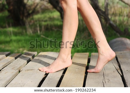 beautiful woman walking without shoes sunny day - stock photo