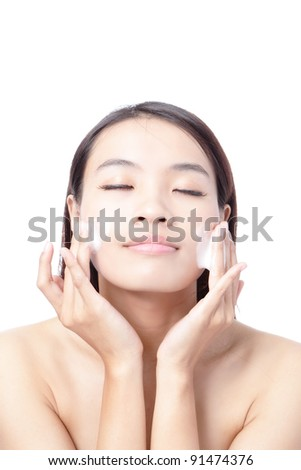 Beautiful woman washing her beauty face with cleansing foam on her hands for skin care concept , isolated on white background, model is a asian girl - stock photo