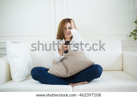 beautiful woman watching television hand holding remote