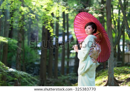 Beautiful woman wearing a Japanese kimono