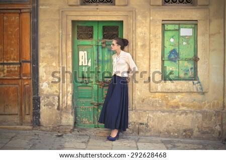 Beautiful woman wearing a long blue skirt - stock photo
