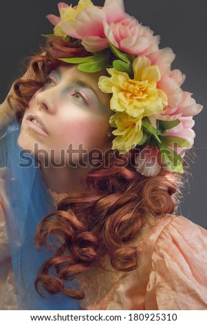 Beautiful Woman Wearing a Wreath of Pastel Flowers - stock photo