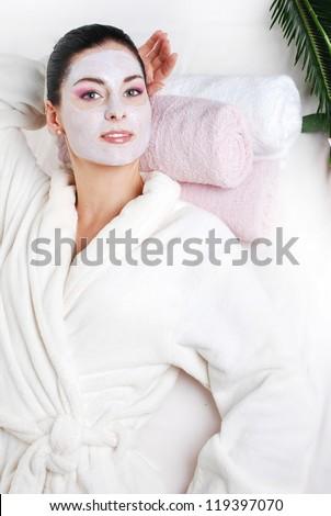 Beautiful woman wearing bathrobe. In spa - stock photo