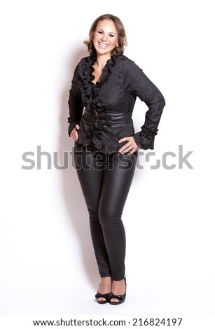 beautiful woman wearing black upscale outfit on white background