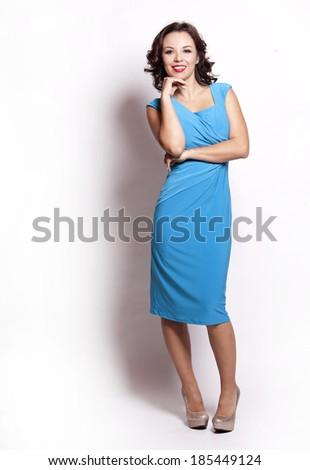 beautiful woman wearing blue dress on white background - stock photo