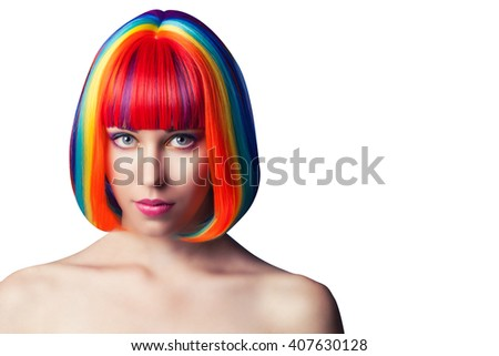 beautiful woman wearing colorful wig against white background - stock photo