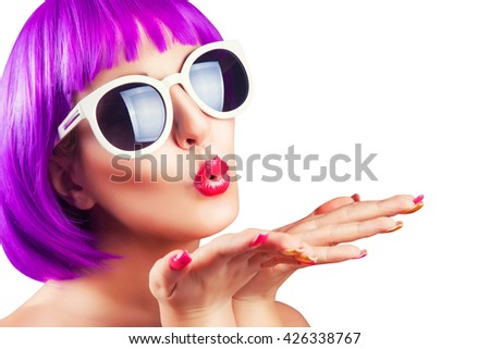beautiful woman wearing colorful wig against white background